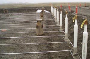 Thermosiphons installed at the Nikaitchuq oilfield on Alaska's North Slope, where they cool the ground and keep permafrost from thawing beneath a warehouse.