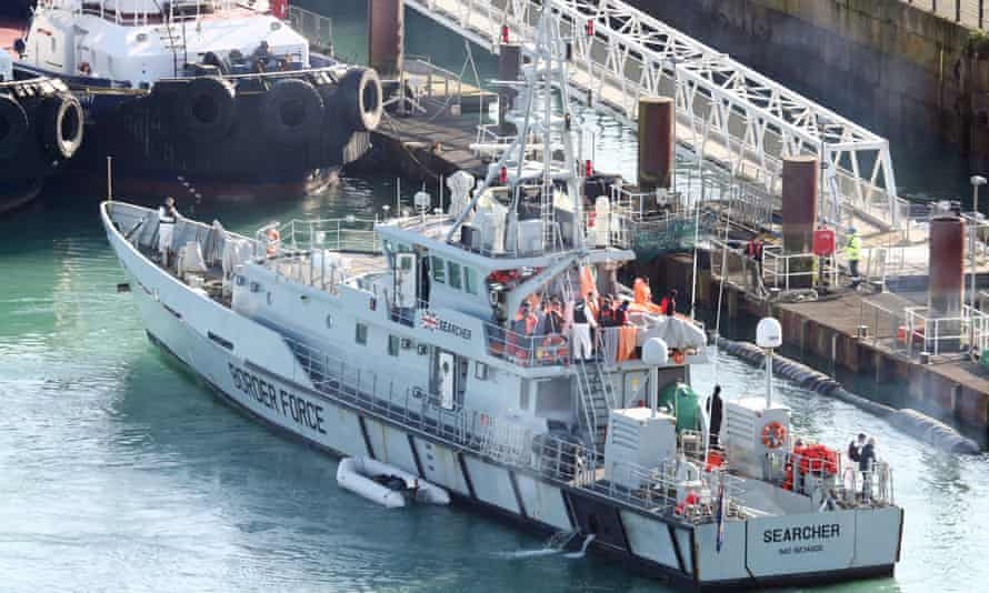Migrants are brought ashore on the Border Force vessel Searcher in Dover earlier this year.