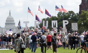 Trump supporters gather on the National Mall in Washington on Saturday for a rally - but some of his backers question his recent bipartisan moves