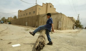An Iraqi boy plays in front of a closed synagogue in Baghdad, 2003. Iraq's Jewish community numbered more than 100,000 in the 1930s