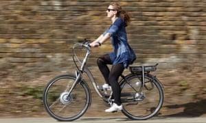 A woman riding an e-bike