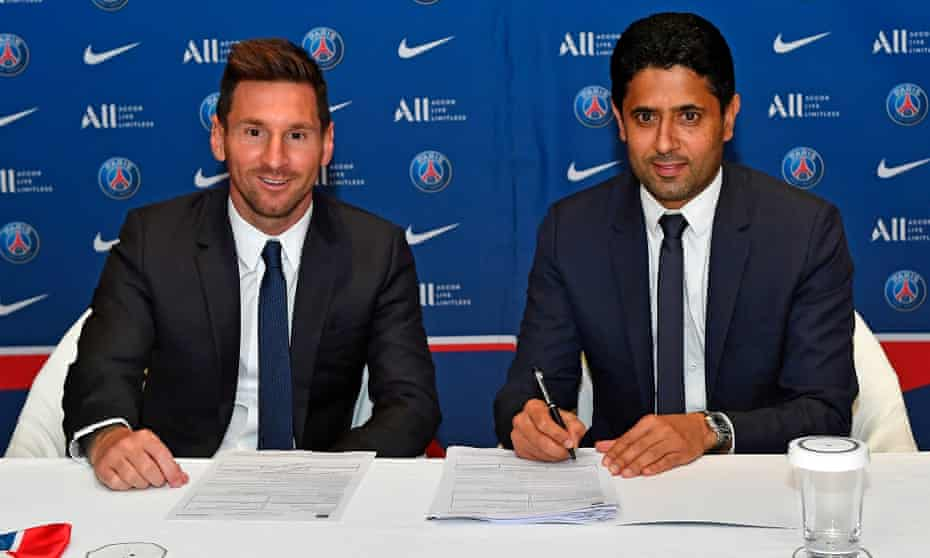 Lionel Messi poses alongside PSG president Nasser al-Khelaifi after signing his contract.