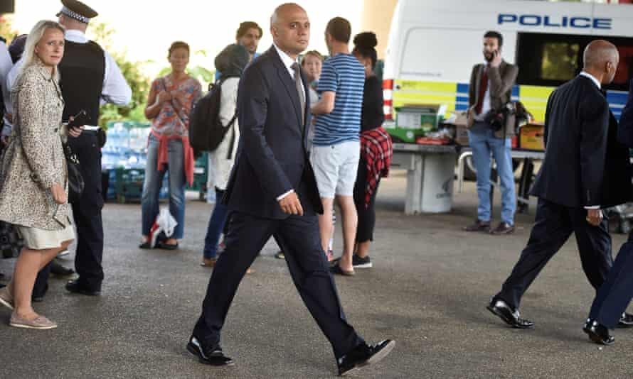 Sajid Javid visits the scene of the fire in west London.