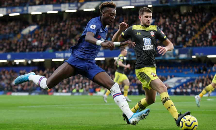 Chelsea's Tammy Abraham of Chelsea is challenged by the Southampton defender Jack Stephens.