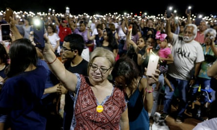 Mourners at an El Paso community vigil on Sunday night for shooting victims.