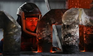 A worker at a conventional aluminium smelting facility in Fort William in the UK