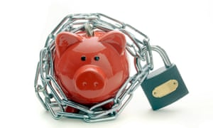 Piggy bank protected by a padlock and chain