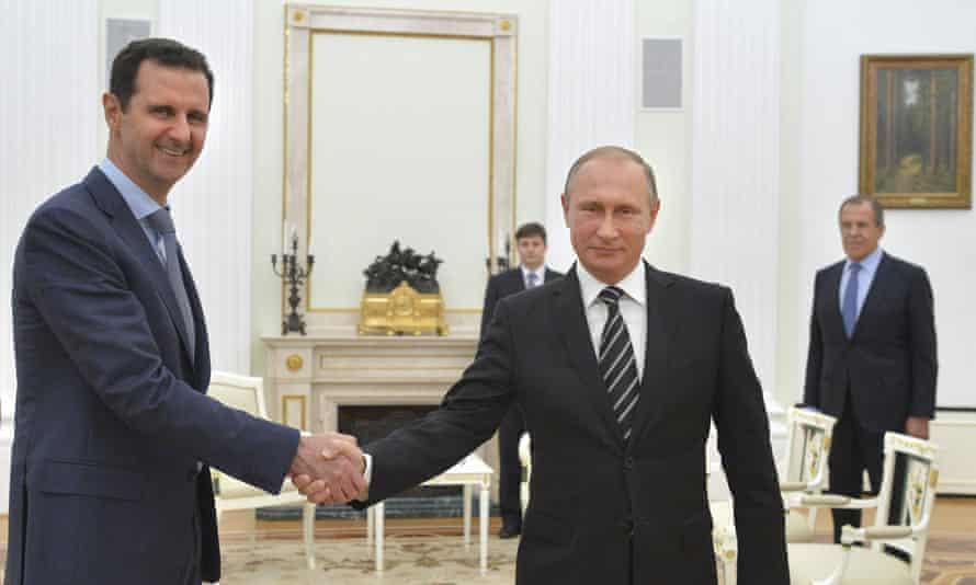 President Assad shakes hands with Vladimir Putin at the Kremlin last month.