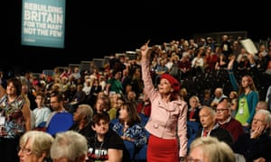 Delegates raise their hands during a debate on day two of the Labour party conference in Liverpool.