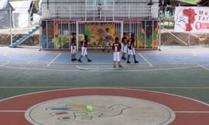 A kids' team warms up ahead of their game in the group stage of a Farc-organised tournament held in La Elvira