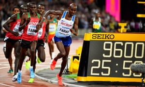 Mo Farah stumbles at the front of the race.