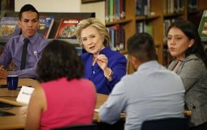 Hillary Clinton speaks with a group, including students, about immigration during a round at an event at Rancho High School in Las Vegas.