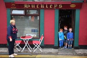 Young cousins from Cork City wait for the parade to pass
