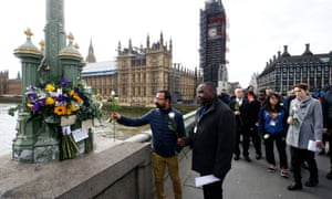 Members of the public pay their respects on Westminster Bridge