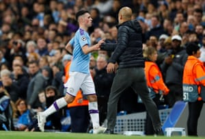 Phil Foden shakes hands with Pep Guardiola after being sent off.