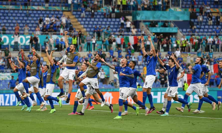 Italy's players celebrate after making it three wins out of three in the group stage by beating Wales