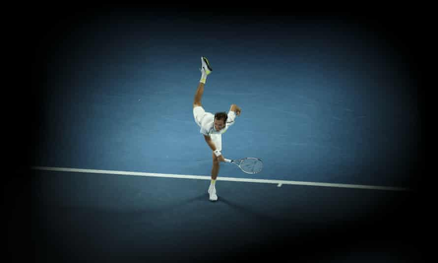 Daniil Medvedev serves Stefanos Tsitsipas during their semi-final match at the Australian Open.