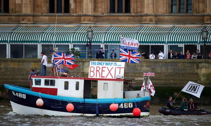 A 'Fishing for Leave' boat sails past the Houses of Parliament, 15 June 2016.