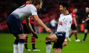 Son Heung-min celebrates scoring Tottenham's third with Harry Kane.