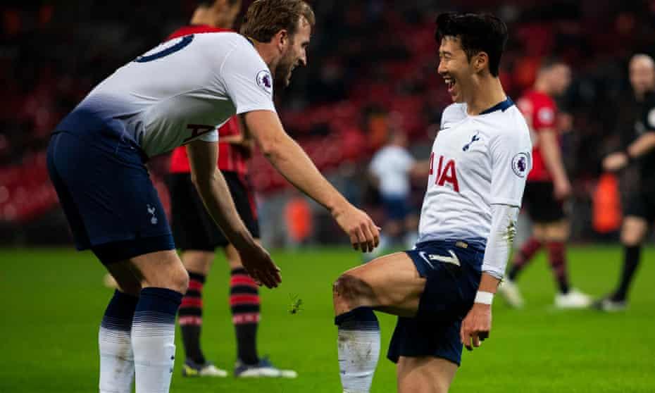 Son Heung-min celebrates scoring Tottenham's third with Harry Kane.