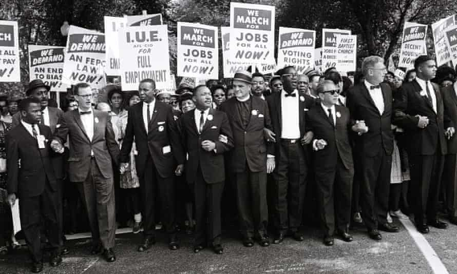 Martin Luther King and other civil rights leaders lead a crowd of hundreds of thousands at the March on Washington for Jobs and Freedom in August 1963.