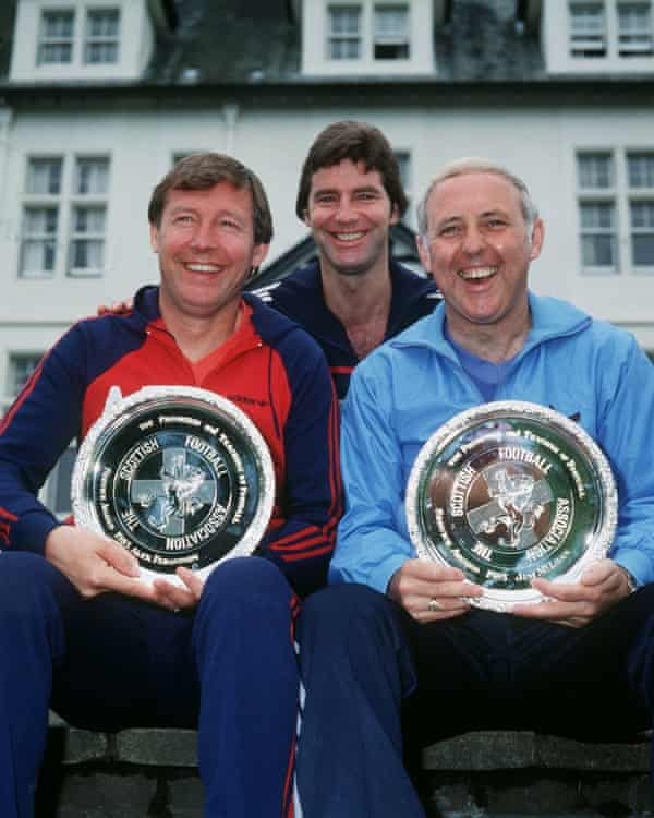 Jim McLean, right, with Alex Ferguson, the manager of Aberdeen, left, and Scotland player Martin Buchan after the presentation of awards for the promotion and teaching of football, 1985.