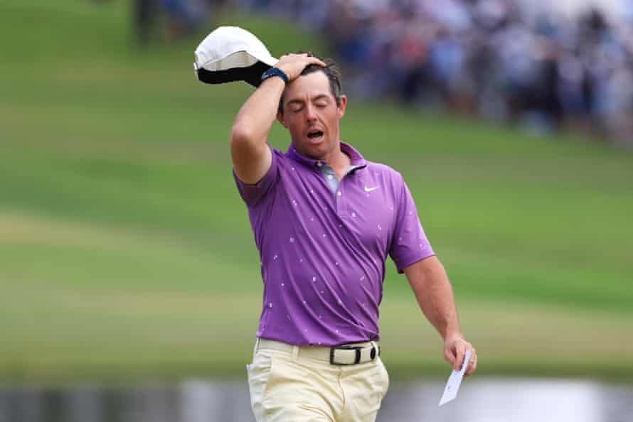 Rory McIlroy reacts on the 18th green.