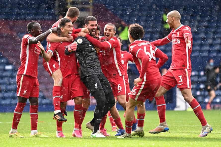 Alisson Becker is mobbed by teammates after scoring for Liverpool at West Brom.