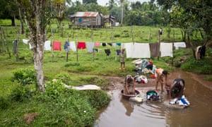 Miskito women wash clothes in Francia Sirpi, near Nicaragua's eastern coast