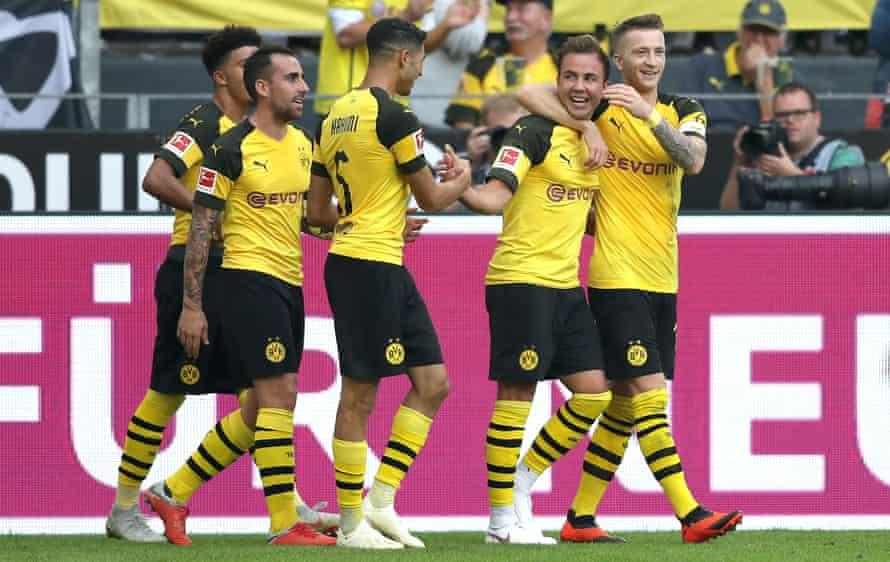 Mario Götze is congratulated after scoring Dortmund's third goal in their thrilling win.
