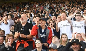 Charlie Cooper next to his father, Paul, at a Fulham game.