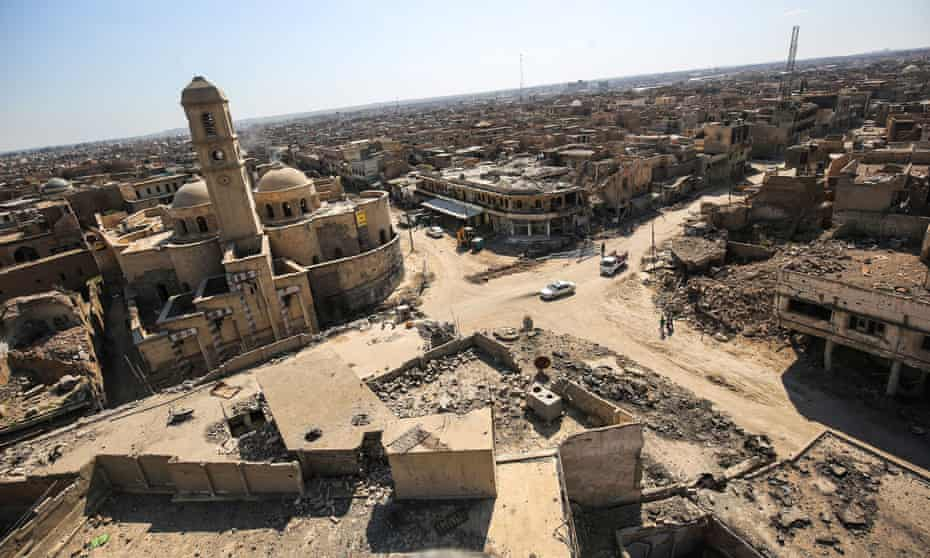 Destruction surrounding the Roman Catholic Church of Our Lady of the Hour (L) in the old city of Mosul