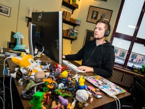 Laidback workplace … Kris Jelbring, systems team lead, sits at his desk filled with video game figurines.