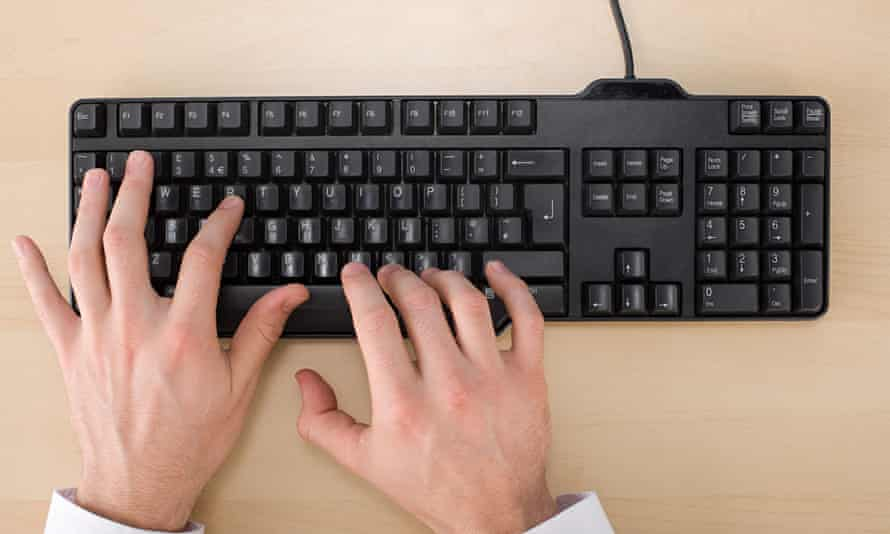 man's hands using keyboard