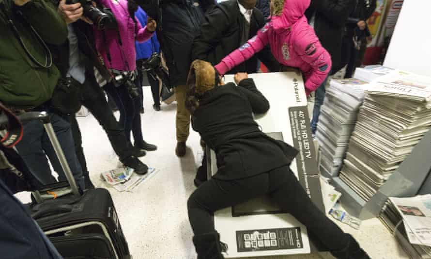 shoppers tussle over a TV in Asda