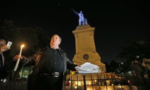 Charles Lincoln speaks during a candlelight vigil at the statue of Jefferson Davis in New Orleans on Monday, in protest at the removal of Confederate monuments.
