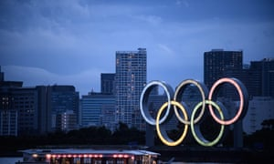 A Japanese houseboat sails past the Olympic rings in Tokyo on Friday
