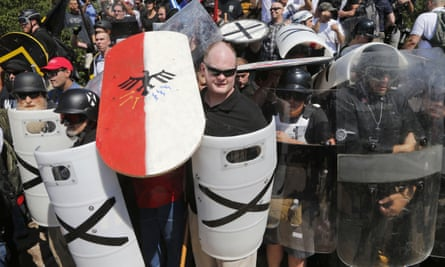 White nationalist demonstrators use shields as they guard the entrance to Lee Park in Charlottesville, Virginia.