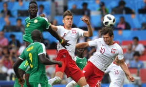 Poland's Grzegorz Krychowiak heads home from a free-kick in their defeat against Senegal.