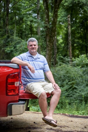 Kevin Davis sits on the tailgate of his truck in Simpson County, Mississippi.