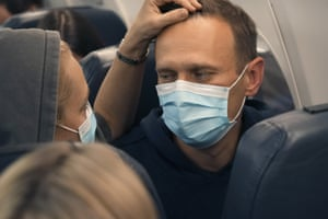 Alexei Navalny and his wife Yulia sit on the plane at Berlin Brandenburg airport before taking off for Moscow.