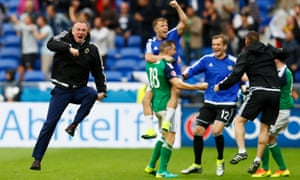 Northern Ireland head coach Michael O'Neill celebrates after Niall McGinn scored their second.