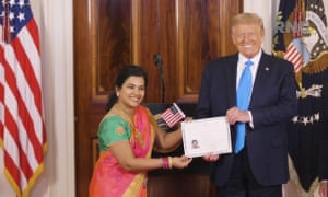 Donald Trump stands with a newly naturalized US citizen during the Republican National Convention.