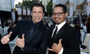 John Travolta and Michael Peña at the Church of Scientology Celebrity Centre 44th Anniversary Gala in in Los Angeles.