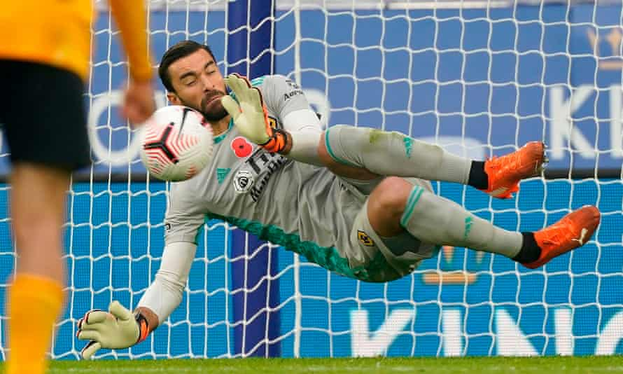 The Wolves goalkeeper, Rui Patrício, saves Jamie Vardy's second penalty of the match after diving to his right.