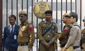 Policemen stand guard outside the high court in New Delhi.