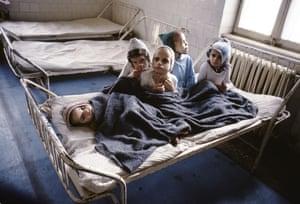 Orphans share a bed in Stefan Nicolau hospital Bucharest, Romania 1990.