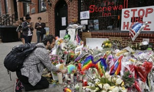 A man lights candles on a memorial outside the Stonewall Inn for victims of the Orlando shooting.