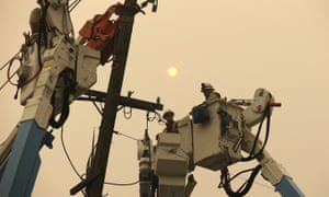 Pacific Gas & Electric crews work on power lines in Paradise, California.