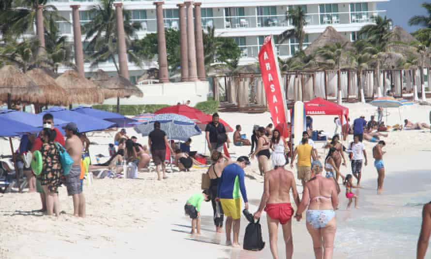 Tourists crowd the beach at Cancún this week.